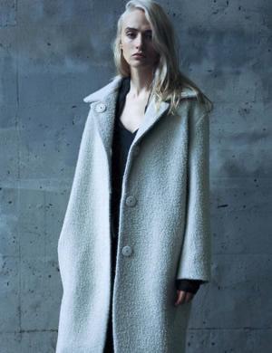 Woman wearing grey overcoat image photo.
